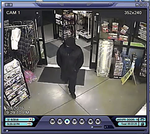 Surveillance video of a robbery at Dollar General in Stephens City is shown..